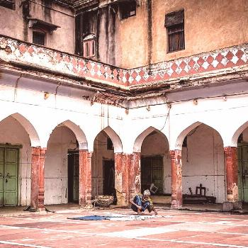 ..a resident man drying his clothes at the min-17th century Fatehpuri Mosque..  @ Chandni Chowk mar