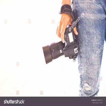 Photographers stand ready to work and Photography is happiness.\nIn the photographer's hand there i